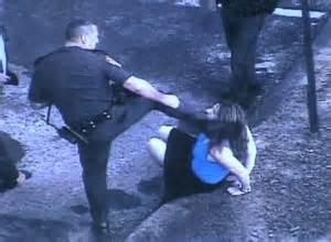 Police abuse, cop kicks woman in the head.