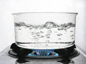 Boiling water is bubbles breaking through the surface.
