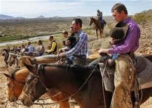 Bundy ranch defenders and patriots pray for a peaceful outcome while government SWAT teams prepare to open fire on them