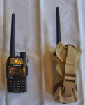 Baofeng UV-5RA carried in a flash bang grenande pouch
