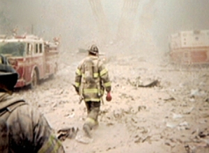 9/11 firefighter walking to building pile to save people.
