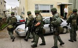 SWAT confiscating guns