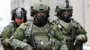 highly armed, militarized SWAT teams protect the government