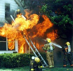 Fireifghter on ladder on fire burning