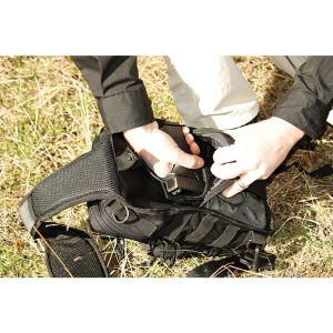 Pistol in the rear pocket up against your back. But the pack is well-padded.